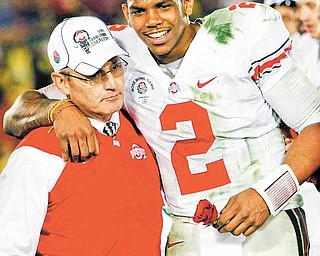 FILE-This Jan. 1, 2010 file photo shows Ohio State head coach Jim Tressel, left, and MVP Terrelle Pryor celebrating after winning the Rose Bowl NCAA college football game against Oregon  in Pasadena, Calif. The Ohio State quarterback, full of potential but surrounded by controversy, announced through his attorney on Tuesday June 7, 2011, that he would give up what remained of his senior season. (AP Photo/Mark J. Terrill,File)
