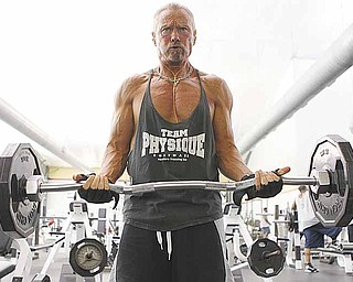 Ken Johnson from Waterloo, Illinois, works out at Bally Total Fitness, May 16, 2011, in Maryland Heights, Missouri. Johnson is an all-natural bodybuilder at age 60 who has not used steroids to alter his physique. (Johnny Andrews/St. Louis Post-Dispatch/MCT)