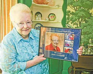 Jean Marie Schlecht of Warren was inducted last month into the Ohio Senior Citizens Hall of Fame. Schlecht, holding the plaque she received from the Ohio Department of Aging, was recognized for more than a half-century of volunteer work in Trumbull County.