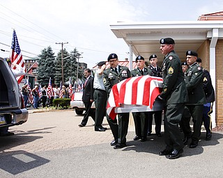 NEW CASTLE, PA - JUNE 11:  The honor guard carries the flag-draped casket of Staff Sgt. Edward Mills Jr. to the hearse on June 11, 2011 in New Castle, PA.  (photo by:  Justin K. Aller)