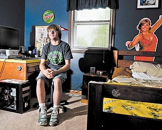 Despite the cerebral palsy that severely weakened his legs, Anthony Hartwig, 19, never lost his athletic drive. Using his canes, he'll walk across the graduation stage today at South Range High School to receive his diploma.
