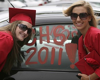ROBERT  K.  YOSAY  | THE VINDICATOR --..Stopping for a memory are Cally Wollet and Nikki Calai at Canfield High School 2011 graduation at the Stadium - .. -30-..(AP Photo/The Vindicator, Robert K. Yosay)