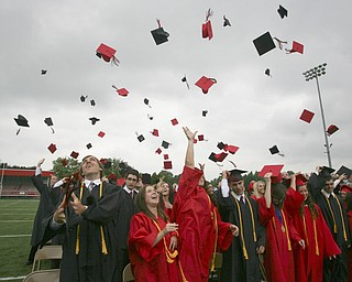 ROBERT  K.  YOSAY  | THE VINDICATOR --..THEY ARE DONE  as the Class of 2011  toss their hats at the end of the ceremony -- Canfield High School 2011 graduation at the Stadium - .. -30-..(AP Photo/The Vindicator, Robert K. Yosay)