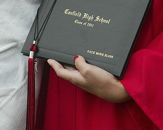 ROBERT  K.  YOSAY  | THE VINDICATOR --..tassel and diploma  - Canfield High School 2011 graduation at the Stadium - .. -30-..(AP Photo/The Vindicator, Robert K. Yosay)