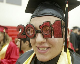 William D Lewis the Vindicator  Girard HS grad Austin Nitzsky sports  some theme glasses for commencement ceremony Sunday at GHS.