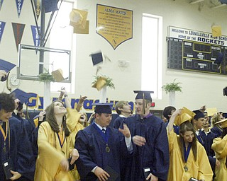 William D Lewis the Vindicator  Lowellville  HS 2011commencement ceremony Sunday at Lowellville HS. Grads toss their caps at end of ceremony.