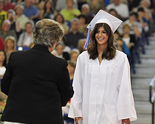 Poland High School senior Mary Carchedi smile sbefore being handed her diploma.