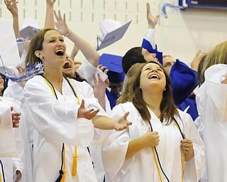Poland High School Senior's Danielle Mullis, and Lidia Mowad throws their caps in the air after graduating.