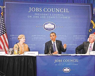 President Barack Obama speaks at the beginning of a meeting with the Jobs and Competitiveness Council at the corporate and U.S. manufacturing headquarters of Cree, a leading manufacturer of energy-efficient LED lighting. Monday, June 13, 2011, in Durham, N.C. Seated left of Obama is Ellen Kullman and right is Jeff Immelt, Chair, The President's Council on Jobs and Competitiveness. (AP Photo/Carolyn Kaster)