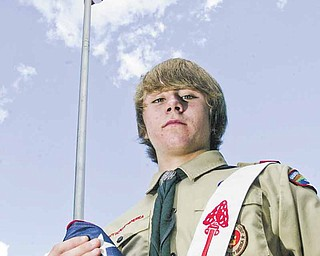 Eagle Scout candidate Greg Haylett, 16, said the lighted flagpole he's planning to install at Poland Township Park will also serve as a 9/11 memorial. The pole behind him is at Poland United Methodist Church.