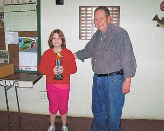 When the Hubbard Conservation Club had its Kids' Fishing Derby recently, the top winner was Alexandria McFarland, 11. Here, Ed Wolfinger stands with Alexandria after presenting her with the First Place Overall trophy.