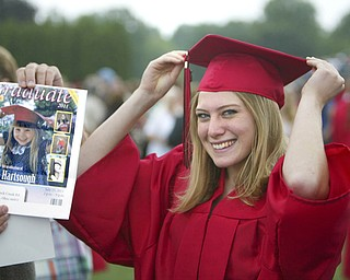 ROBERT  K.  YOSAY  | THE VINDICATOR --..Still pretty as a picture --Leanna Hartsough  the and now as she imitates her graduation from pre school and now as a graduate of Canfield High School -Canfield High School 2011 graduation at the Stadium - .. -30-..(AP Photo/The Vindicator, Robert K. Yosay)