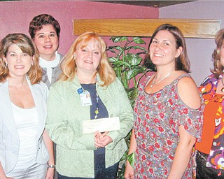 JoAnn Stock, director of development for Akron Children's Hospital Mahoning Valley, holds a check donated by committee members of the Mahoning County Medical Society Alliance, from left to right, Cassie Calderon, Paula Jakubek, Tammy Engle and Carol Sankovic. Not pictured is committee member Shelly Barton.