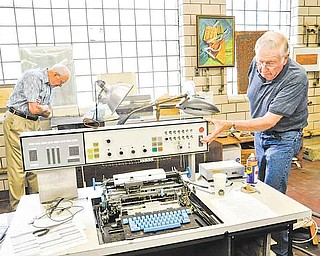 In this May 31, 2011 photo, retired IBM Fellow, Donald Seraphim, left, and retired Senior Associate Engineer, Charles Davis, examine old IBM computers and equipment at the Center for Technology & Innovation in Binghamton, N.Y. (AP/Heather Ainsworth)