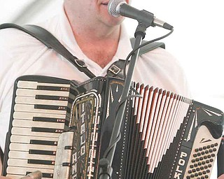 Mikey Dee of the Mikey Dee band traveled from McKeesport, Pa., to play polkas at the Simply Slavic Festival. Several polka bands played Saturday at the festival in downtown Youngstown. Hundreds attended the festival that ended with a Euro disco in the Central Square area late Satuday.