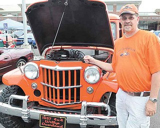 Dave Doepker of Greenford stands with his restored 1957 Willys Overland wagon at the seventh annual Beaver Township Ruritan Father's Day car show Sunday at South Range High School in North Lima.