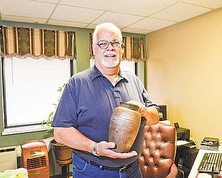 """A resident of Ohio Valley Teen Challenge in Youngstown returned an urn he found in Mill Creek to Pastor Kerry Dean, above, academic dean at Teen Challenge. Etched on the urn, they believe, is: """"Michael L. McBack, Nov. 22, 1955 to Aug. 19, 2007."""""""