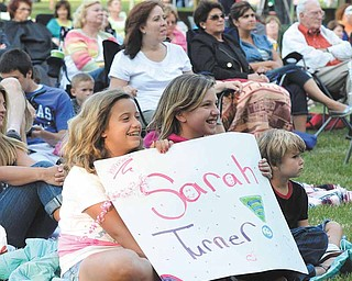 Young fans of Sarah Turner show their support with a homemade sign Wednesday evening at the Judge Morley Pavilion in Mill Creek MetroParks..