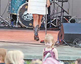 Country musician and Boardman native Sarah Turner performs at the Judge Morley Pavilion Wednesday night as the opening act for the season of the 7-Up Summerfest Spectacular 2011.