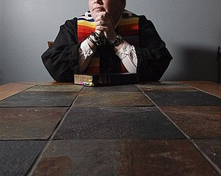 "In this June 16, 2011 photo, Rev. Amy DeLong sits at her home, in Osceola, Wis. While trials of pastors who conduct same-gender ceremonies have only occurred once every several years, the threat is indeed real: DeLong faces a three-day trial starting Tuesday, June 21, 2011, on two charges: violating a church prohibition on the ordination of ""self-avowed practicing homosexuals"" and marrying a lesbian couple. (AP Photo/Stacy Bengs)"