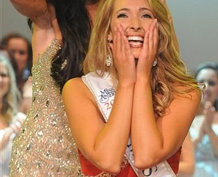 Miss Clayland, Ellen Bryan rejoices as she is crowned Miss Ohio 2011 by the outgoing Miss Ohio Becky Minger on Saturday, June 18, 2011 at the Renaissance Theater in Mansfield, Ohio. (AP Photo/News Journal, Jason J. Molyet)