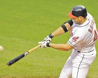 Cleveland Indians' Travis Hafner hits a three-run home run off Colorado Rockies starting pitcher Juan Nicasio in the first inning of a baseball game Monday, June 20, 2011, in Cleveland. (AP Photo/Mark Duncan)