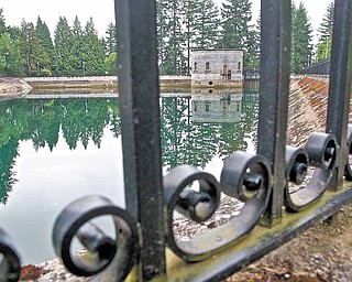 This spot at the Mt Tabor number 1 reservoir Monday June 20, 2011, is where a 21-year-old man was seen on surveillance video urinating into the reservoir in Portland, Ore.  City officials have decided to drain the reservoir at the cost of about $36,000 because of the incident.  (AP Photo/Benjamin Brink/The Oregonian)