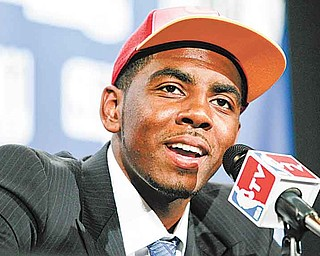 Duke's Kyrie Irving talks to reporters after being selected with the No. 1 pick by the Cleveland Cavaliers during the NBA basketball draft, Thursday, June 23, 2011, in Newark, N.J. (AP Photo/Julio Cortez)
