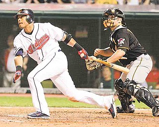 With Pittsburgh Pirates catcher Michael McKenry behind the plate, Cleveland Indians second baseman Orlando Cabrera watches his RBI hit in an interleague baseball game in Cleveland on Friday, June 17, 2011.   (AP Photo/Amy Sancetta)