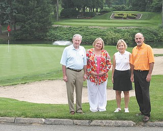 Committee members for the first Clubs for Kids Golf Classic, to take place Aug. 5 at the Youngstown Country Club are, from left, Paul Dutton, Susan Berny, Sallie Tod Dutton and Greg Strollo.