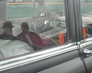 The Rollers members George Becker and Wayne Holcomb are seen in the reflection of Holcomb's Bel-Air. Members of the Cleveland car club were in Salem Friday for the Steel Valler Super Nationals.
