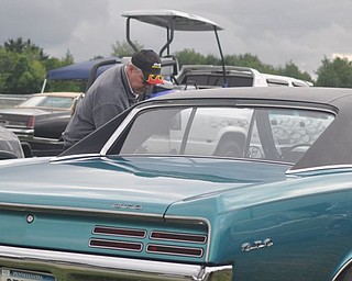 Denny Pevan gets into his GTO. An admitted 'Pontiac fanatic,' Pevan owns two GTOs which he and his wife, Linda, race.