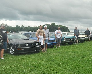 The Gear Busters car club from New Castle, Pa. poses with their cars Friday at the Steel Valley Super Nationals. Member Denny Pevan explains the club is a family that goes everywhere and does everything together. Next, they'll be at Back to the 50s in their hometown.