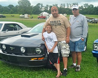 Three generations of racing: Joseph, James and Lou Paglia pose with James Paglia's 2007 Ford Mustang GT at the Steel Valley Super Nationals at the Quaker City Motorsports Park. The trio is part of the Gear Buster's car club.