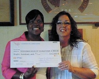 """A gift to Sojourner House: The Ladies Auxiliary of the Fraternal Order of Eagles #213 in Youngstown donated $800 recently to Sojourner House. The funds were raised over the past year by the group, which has donated to the Youngstown facility, its """"President's Charity,"""" since 2006. Above, Cindy Long, president of F.O.E. Ladies Auxiliary 213, right, presents the check to Audrey Walker, house manager of Sojourner House."""