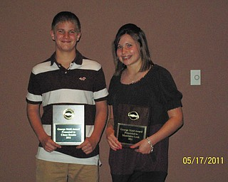 Good sportsmanship: Chase Brooks, left, and Maddie Leek, eighth-graders at Holy Family School in Poland, received the George Mahl Sportsmanship Award at the Athletic Awards Banquet in May at the Holy Family Parish Center. The award, which is earned through votes by fellow classmates, is given annually to two Holy Family School athletes.