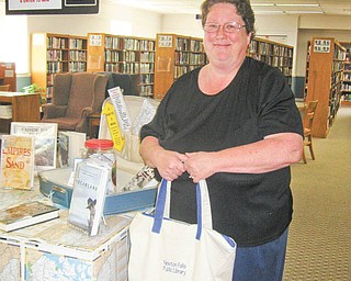 Novel destinations: Monica Butler of Newton Falls was the first week's winner of Newton Falls Public Library's Adult Summer Reading Novel Destinations activities. More prizes will be awarded during the summer at the library, at 204 S. Canal Street.