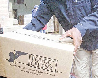 Brad Smith, a wide receiver and kick returner for the New York Jets and a Chaney High School graduate, helped load boxes of food Friday at the Youngstown Salvation Army. The food distribution was a part of Feed the Children and fed 400 families.