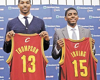 Tristan Thompson, left, and Kyrie Irving hold up Cleveland Cavaliers jerseys, Friday, June 24, 2011, in Independence, Ohio. Irving was the No. 1 overall pick in the 2011 NBA basketball draft and Thompson was the No. 4 overall pick. (AP Photo/Tony Dejak)