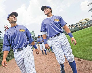 Peoria Chiefs players Greg Rohan, left, and Logan Watkins, walk around the outfield of Wrigley Field before the start of Wednesday's Midwest League game with Kane County.