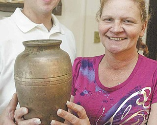 Jesse Lavin, left, a student at Ohio Valley Teen Challenge in Youngstown, recently found the cremation urn of Brenda Hlebak's husband, Michael Hlebak, in Mill Creek Park. Through a series of events, including a story in The