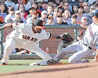 San Francisco Giants' Pablo Sandoval, left, tags out Cleveland Indians' Grady Sizemore on a steal attempt at third base during the second inning of a baseball game Sunday, June 26, 2011, in San Francisco. (AP Photo/George Nikitin))