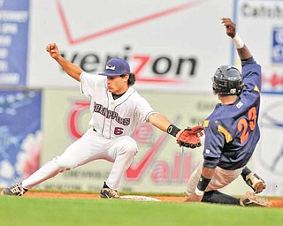 Scrappers second basemen K.C. Serna (6) can't catch a wild throw as Samuel Gonzalez of State College advances to second base on a wild pitch in the fourth inning.