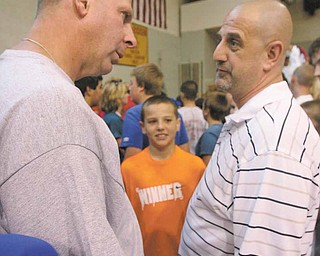 JESSICA M. KANALAS || THE VINDICATOR..Bo Pelini Nebraska Coach talks with Karl Scheetz and his son Luke 11, of New Springfield after the camp.MooneyÕs Camp of Champions. -30-
