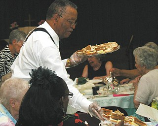 Vernon Brown of Poland served as one of the waiters at the English Tea on June 9 at Trinity United Methodist Church in Youngstown, where he is a lay leader.
