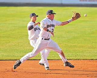 Scrappers third basemen #39 Jordan Smith jumps infront of short stop #1 Tony Wolters to make a play on the ball.