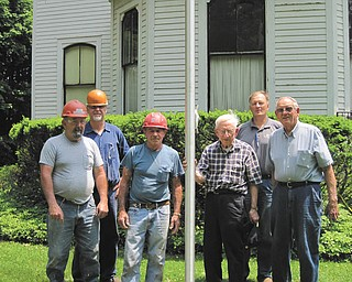 The Niles Historical Society recently received a new 25-foot flagpole and a new flag, thanks to the help of Niles businessmen Alan Miller, general manager at RTI International Metals, and James Williams of Holloway-Williams Funeral Home. A crew from RTI installed the foundation and the pole, and Williams donated the flag. Here, David Dinsmore, left, Bob Mostoller, Bill Dennis, Fred Kubli, Greg Billock and George John display the new pole. Kubli and John are members of the historical society; the others are associated with RTI.