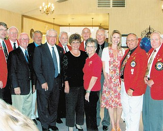 Canfield Lions Club has installed new officers. Those participating were, from left to right, front row, John Africa, Phil Bova, Joan Filisky, Caroline Phillips, Dr. Carmela Abraham, Harry Pancher and Ted Filmer, and back row, Dave Gauch, district governor-elect, installing officer; Tom Zurawick; Don Kwolek; Rich Yager; Pete Cannell; and Jack Patrick. Board members not pictured are Chris Haus, Jim Duncan and Marilyn Schmidt.