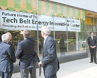 Warren Mayor Michael O'Brien and others involved in the Tech Belt Energy Innovation Center check out the new sign for the center, a 37,000-square-foot building near Courthouse Square in downtown Warren. A ceremony to unveil the space took place Wednesday.