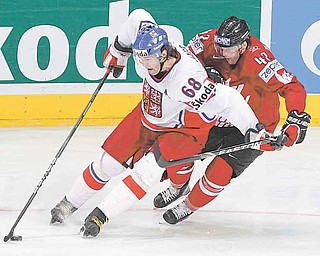 FILE - In this May 18, 2010 file photo, Czech Republic's Jaromir Jagr, left, stick handles the puck away from Team Canada's Rich Peverley during second period action at the IIHF World Hockey Championship in Mannheim, Germany. Petr Svoboda, Jagr's agent, said Tuesday, June 2,1 0211, that he has been talking to the Detroit Red Wings and Pittsburgh Penguins about the Czech star returning to the NHL. Jagr hasn't played in the NHL since the 2007-08 season with the New York Rangers.  (AP Photo/The Canadian Press, Jacques Boissinot, File)